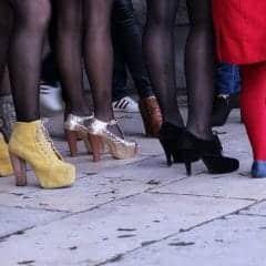 Women legs in a crowdy place